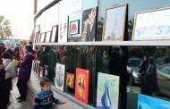 معرض فني لأحد متحدي مرض السرطان بمستشفى 57357